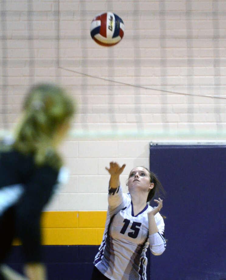 Midland's Emily Wickman serves against Abilene on Sept. 6 at Midland High. James Durbin/Reporter-Telegram Photo: JAMES DURBIN