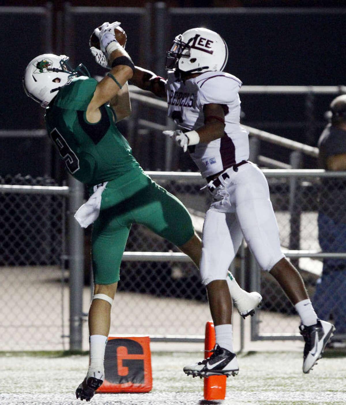Southlake Carroll's Luke Timian catches a touchdown pass despite the efforts of Lee's Juwan Lee on Sept. 6. (Star-Telegram/ Richard W. Rodriguez)