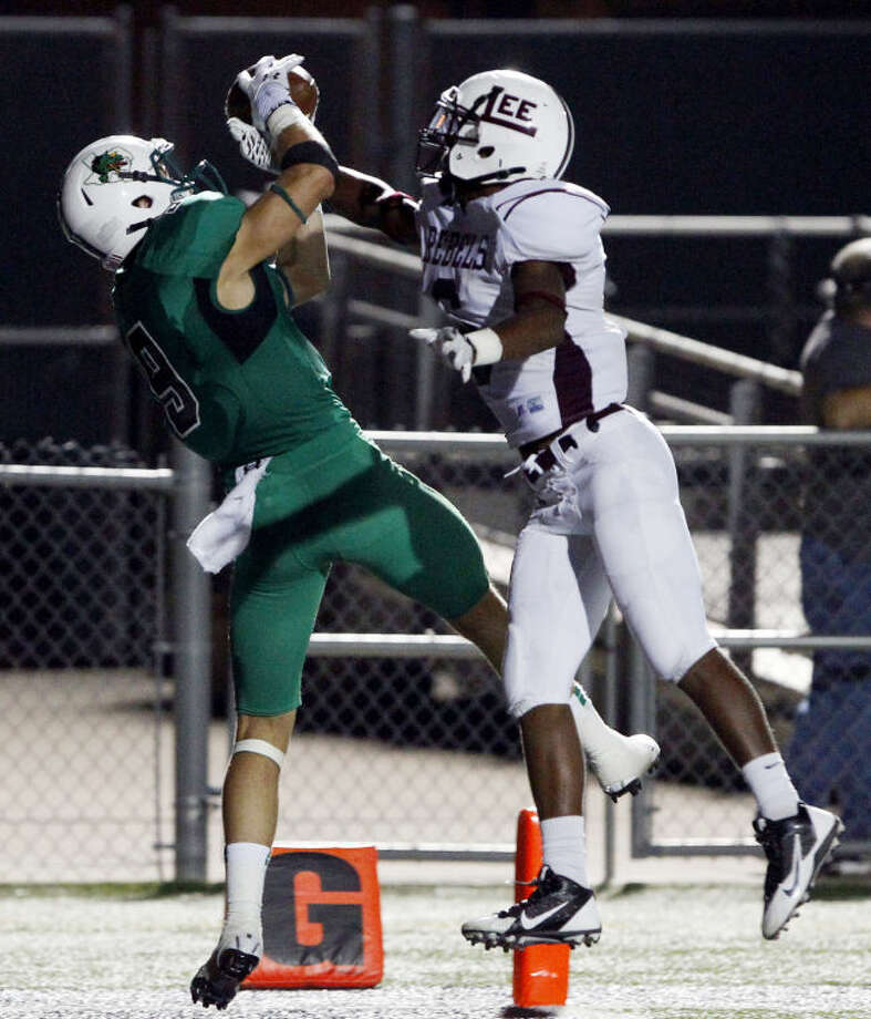 Southlake Carroll's Luke Timian catches a touchdown pass despite the efforts of Lee's Juwan Lee on Sept. 6. (Star-Telegram/ Richard W. Rodriguez) Photo: Richard W. Rodriguez