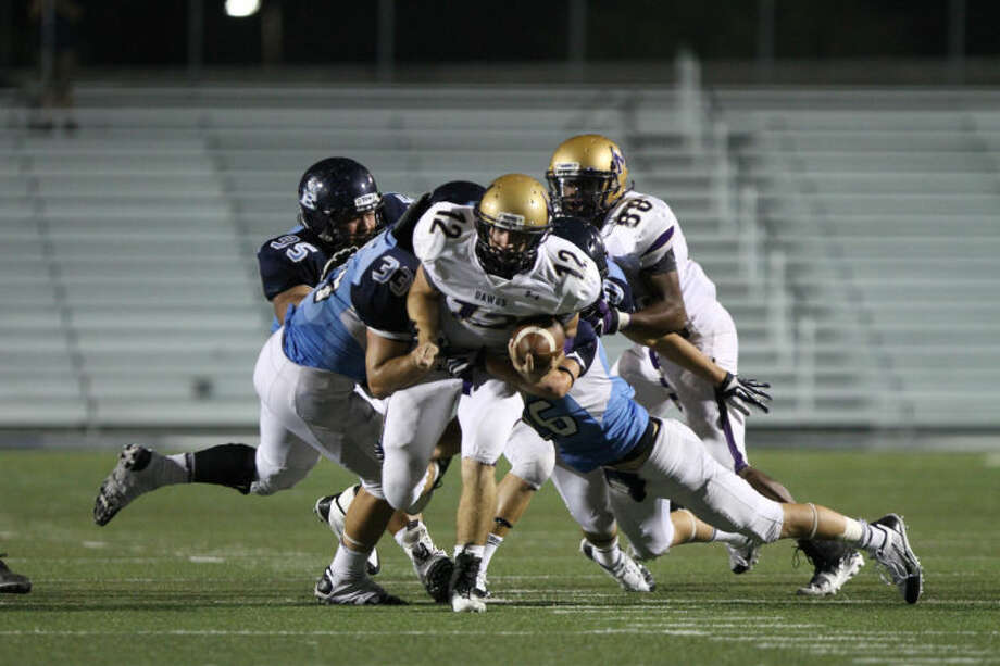 06 September 2013: Miidland Bulldogs quarterback Sam Grimes (12) tries to run through the LD Bell Blue Raider defense during the game between the LD Bell Blue Raiders and the Midland Bulldogs at Pennington Field in Bedford, Texas. Photo: Matt Pearce