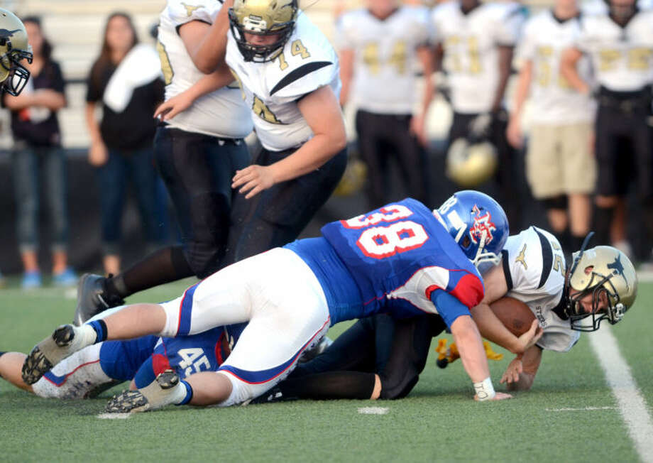 Midland Christian's Dakota Jones (45) and Brandon Glossop (38) sack Big Spring quarterback Tobyn Tannehill on Friday at Mustang Field. James Durbin/Reporter-Telegram Photo: JAMES DURBIN