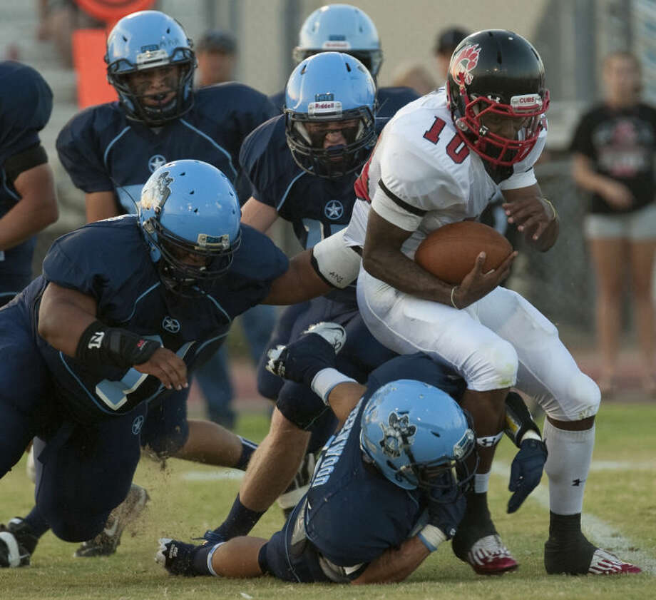 Greenwood's defense tries to stop Brownfield's QB Sha'Colby Hill Friday at JM King Memorial Stadium. Tim Fischer\Reporter-Telegram Photo: Tim Fischer