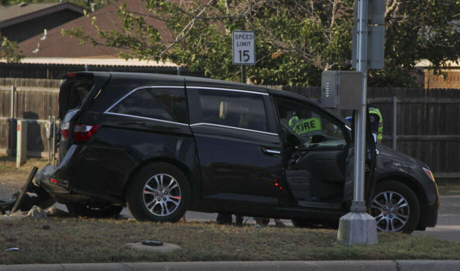 Midland police officers worked to clean up this two-vehicle crash on Sunday near the Trinity School on Wadley Avenue. Tyler White/Reporter-Telegram Photo: TYLER WHITE
