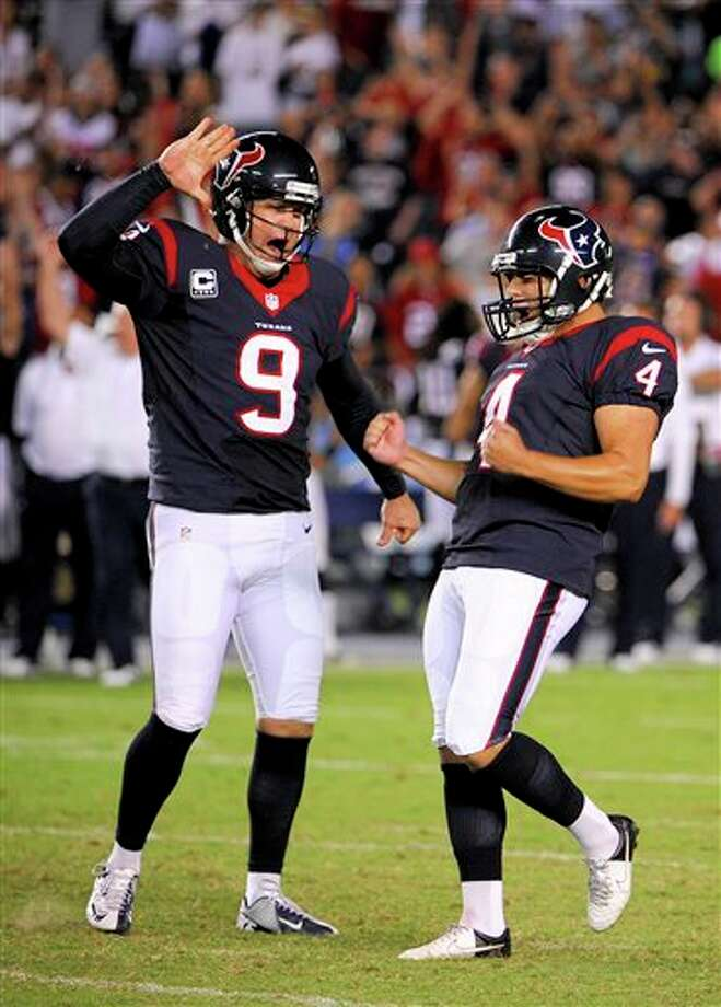 Houston Texans kicker Randy Bullock, celebrates with Shane Lechler after kicking the game winning field goal against the San Diego Chargers during the second half of an NFL football game Monday, Sept. 9, 2013, in San Diego. (AP Photo/Denis Poroy) Photo: Denis Poroy / FR59680 AP