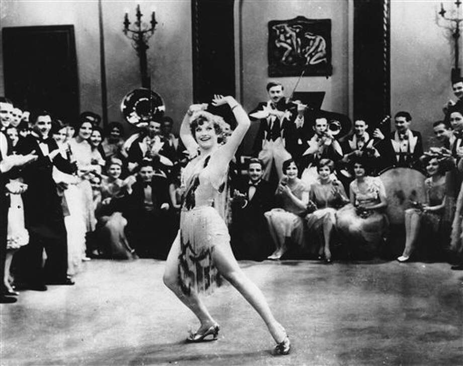 "FILE - In this 1928 file photo, Actress Joan Crawford is seen dancing the Charleston in ""Our Dancing Daughters"" in Hollywood, Calif. A report released, September, 10, 2013, shows that the very wealthiest Americans earned more than 19 percent of the country's household income in 2012, their biggest share since 1928. And the top 10 percent captured a record 48.2 percent of total earnings last year. (AP Photo/File) Photo: STF / AP"