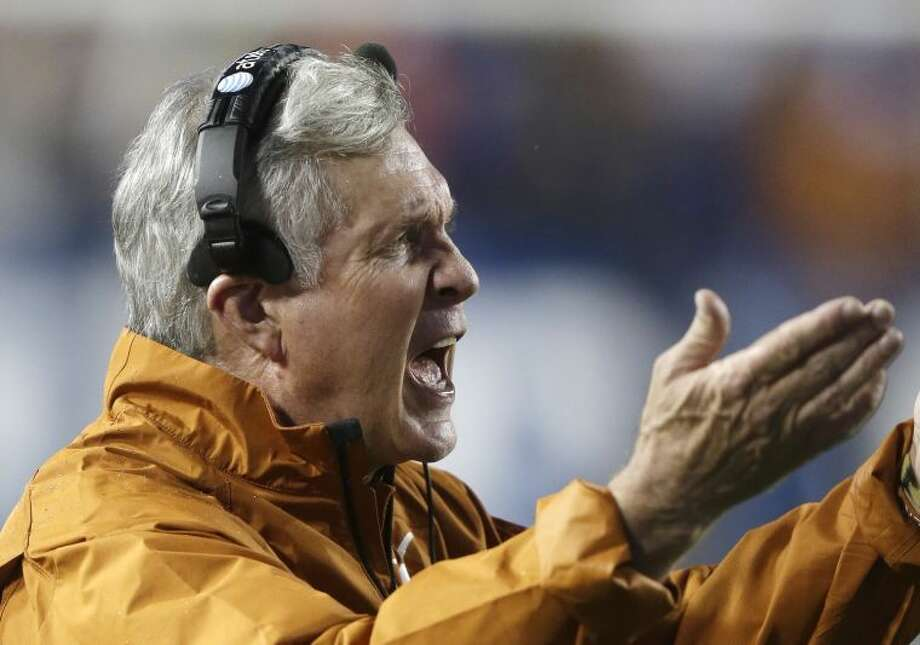 Texas head coach Mack Brown shouts to his team against Brigham Young on Saturday in Provo, Utah. (AP Photo/Rick Bowmer) Photo: Rick Bowmer