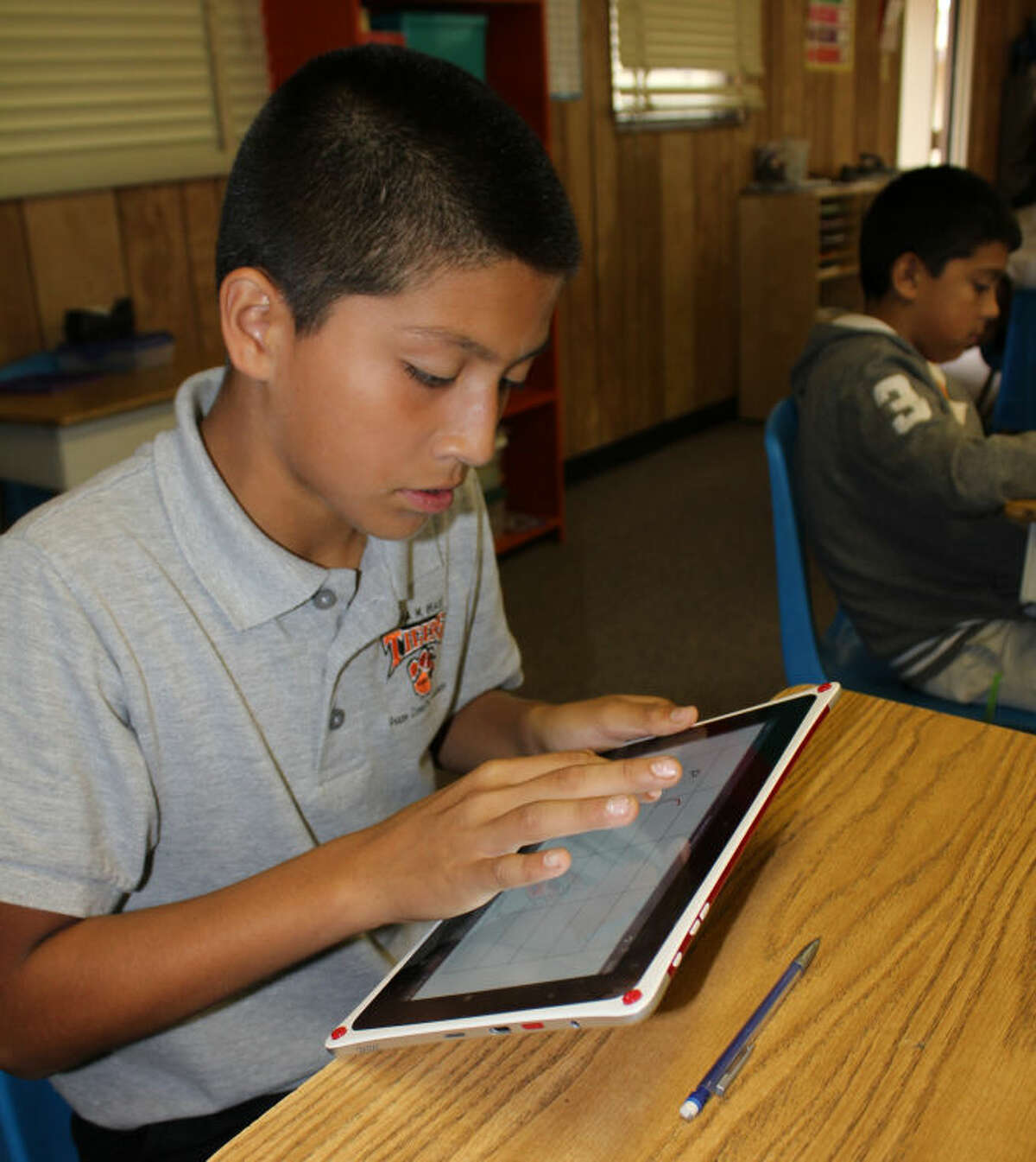 Thomas Davila, 11, uses his LearnPad to complete a worksheet about order of operations Tuesday morning at Pease Communication and Technology Academy. Meredith Moriak/Reporter-Telegram