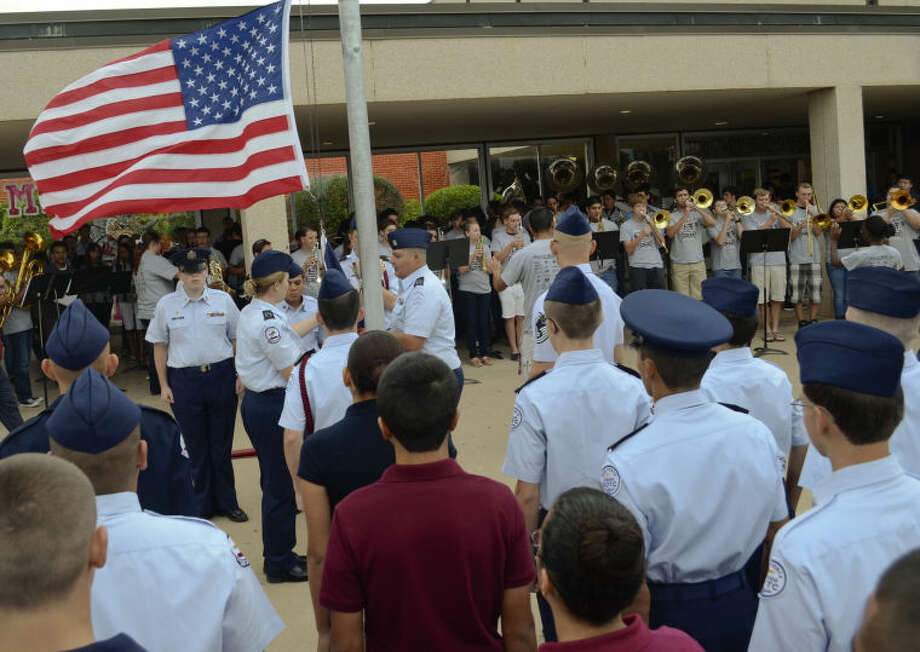 Lee High School JrROTC, band members, students and teachers gather at the flag pole Wednesday outside the school for a special flag ceremony in remembrance of September 11. Tim Fischer\Reporter-Telegram Photo: Tim Fischer