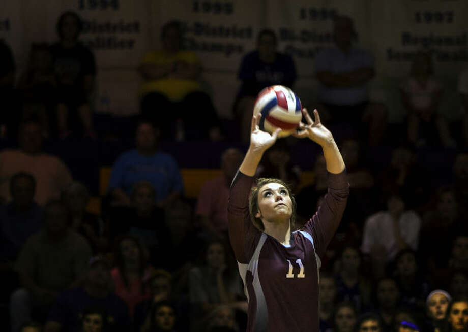 Lee's Bentleigh Dunavan (11) sets the ball during the game against Midland on Tuesday at Midland High. Midland beat Lee in five sets. James Durbin/Reporter-Telegram Photo: JAMES DURBIN