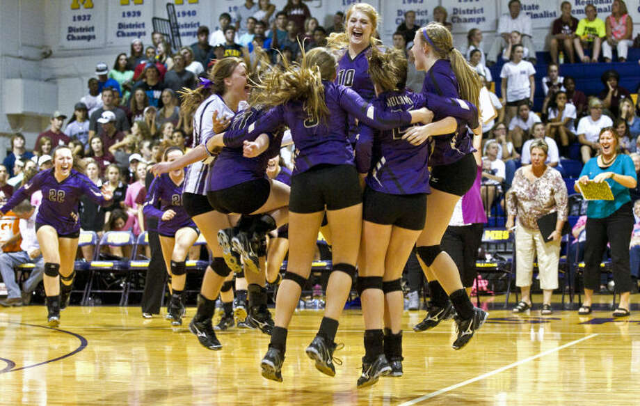 The Midland High girls volleyball team celebrates after beating Lee High in five sets Tuesday at Midland. Channing Burleson (10, at center) had 23 kills against Lee. James Durbin/Reporter-Telegram Photo: JAMES DURBIN
