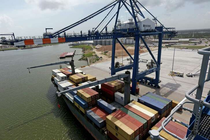 A ZMPC crane loads a cargo ship with containers at Port Freeport Thursday, July 9, 2015, in Freeport,