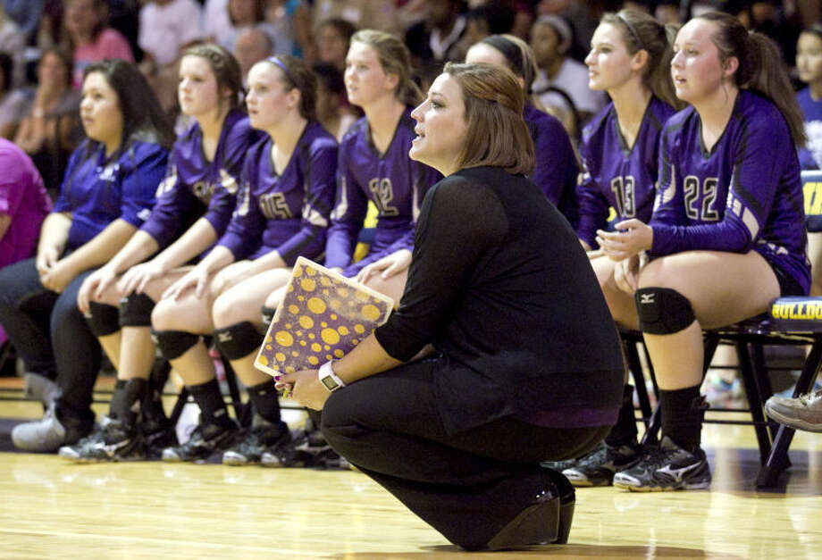 Midland volleyball head coach Amanda Lopez looks on during the game against Lee on Tuesday at Midland High. Midland beat Lee in five sets. James Durbin/Reporter-Telegram Photo: JAMES DURBIN