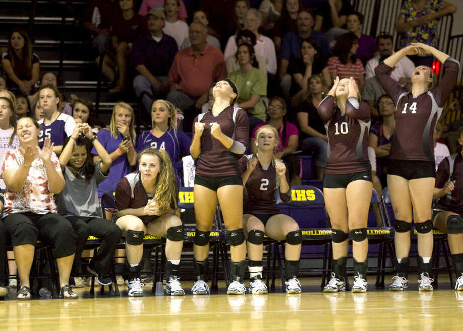 The Lee varsity volleyball team reacts on the bench during the game against Midland on Tuesday at Midland High. Midland beat Lee in five sets. James Durbin/Reporter-Telegram Photo: JAMES DURBIN