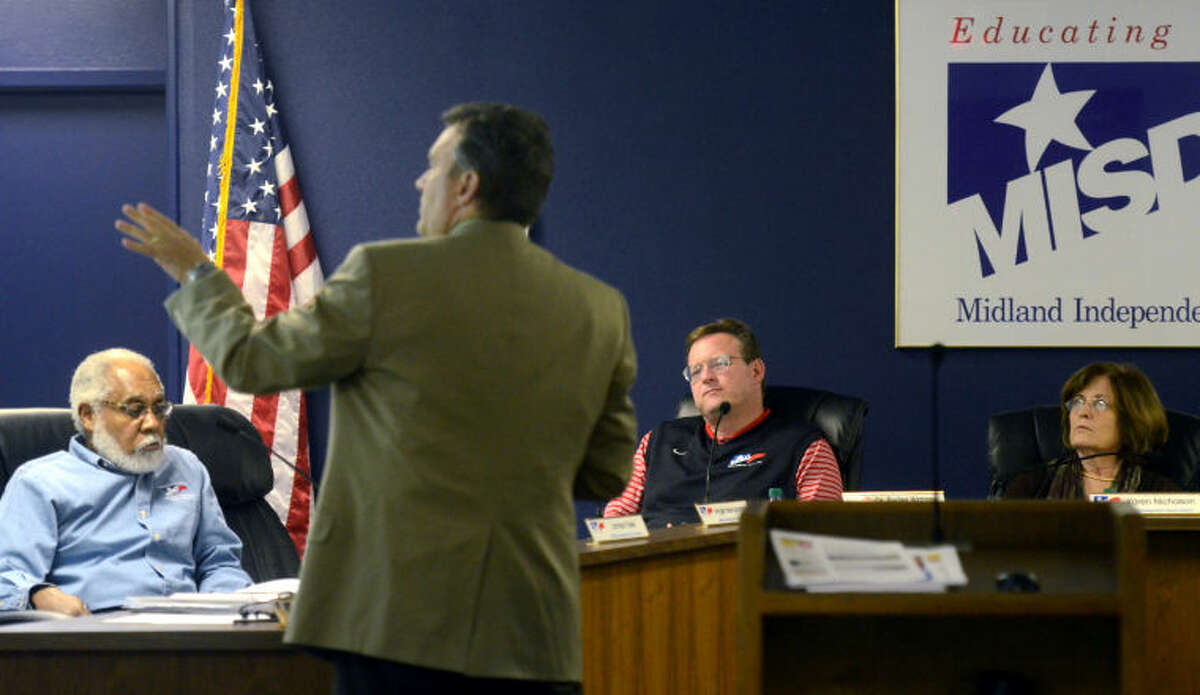 A representative from the Corgan architectural firm based out of Dallas gives a presentation to MISD board members James Fuller, left, Superintendent Dr. Ryder Warren, center, and Karen Nicholson, right, Thursday in the MISD Boardroom. James Durbin/Reporter-Telegram