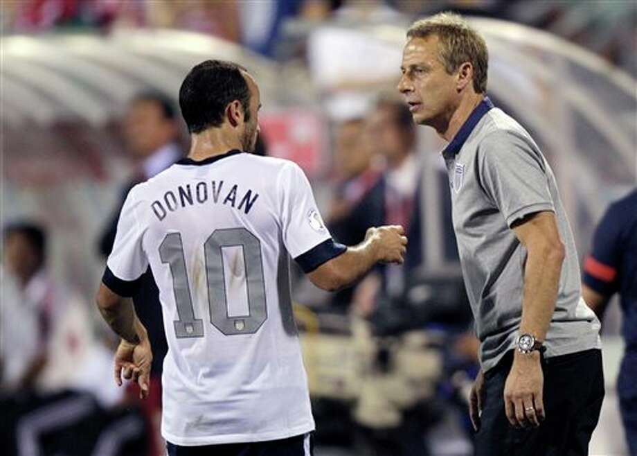 In this photo taken Tuesday, Sept. 10, 2013, United States manager Jurgen Klinsmann, right, talks with Landon Donovan during a World Cup qualifying soccer match against Mexico in Columbus, Ohio. The United States clinched its seventh straight World Cup appearance, getting second-half goals from Eddie Johnson and Donovan on Tuesday night in a 2-0 win over Mexico.(AP Photo/Jay LaPrete) Photo: Jay LaPrete / FR52593 AP