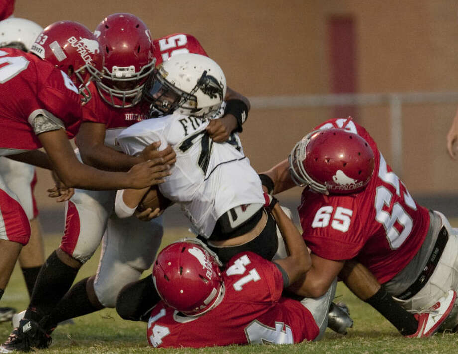 Forsan's Kolby Self gets little yardage as Stanton's Esteban Escamilla, 63, Mark Gonzalez, 55, Jonathon Ramos, 14, and Mason Myrick, 65 combine to stop him Friday night in Stanton. Tim Fischer\Reporter-Telegram Photo: Tim Fischer