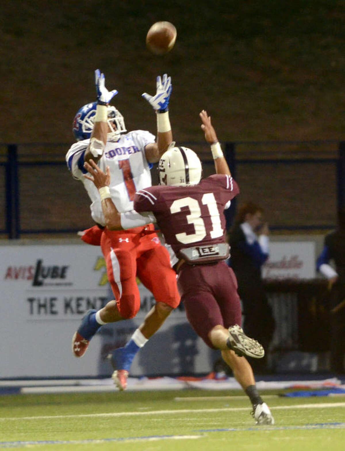 Lee's Anthony Navarrete tries to break up a pass intended for Abilene Cooper's Trey Dye on Friday at Grande Communications Stadium. James Durbin/Reporter-Telegram