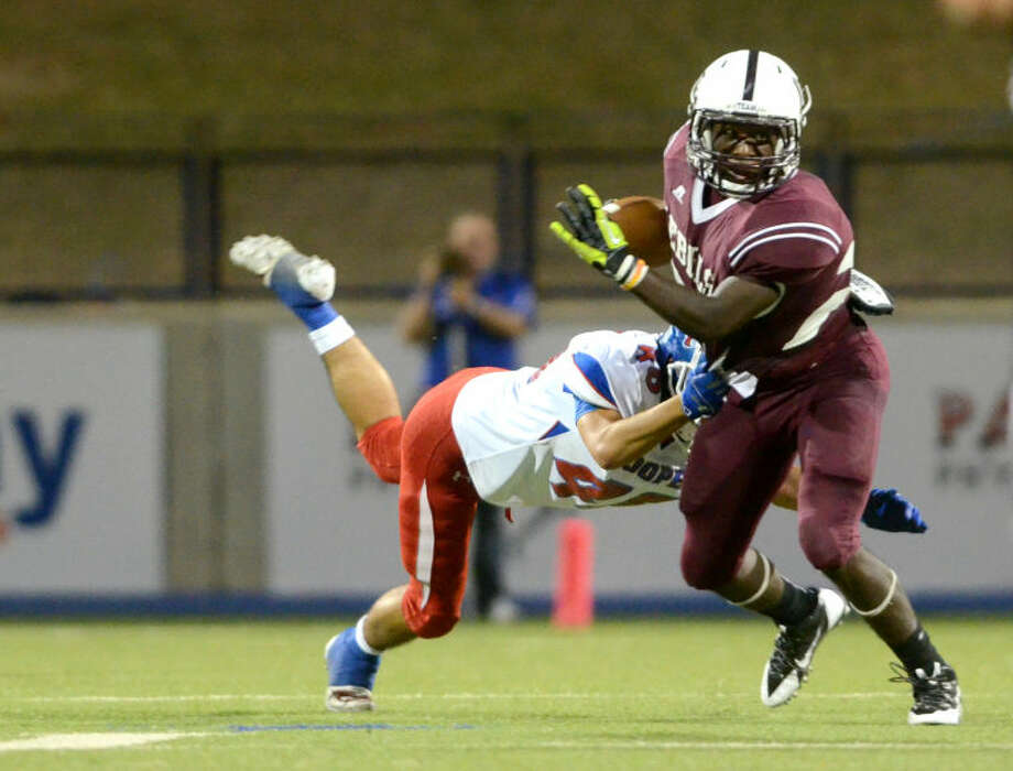 Lee's Aron Dobbins breaks a tackle from Abilene Cooper's Elijah Revilla last month at Grande Communications Stadium. James Durbin/Reporter-Telegram Photo: JAMES DURBIN