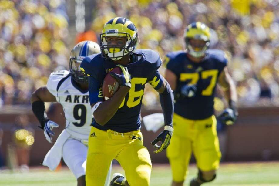 Michigan wide receiver Jehu Chesson (86) runs for a touchdown in the third quarter of an NCAA college football game in Ann Arbor, Mich., Saturday, Sept. 14, 2013. Michigan won 28-24. (AP Photo/Tony Ding) Photo: Tony Ding