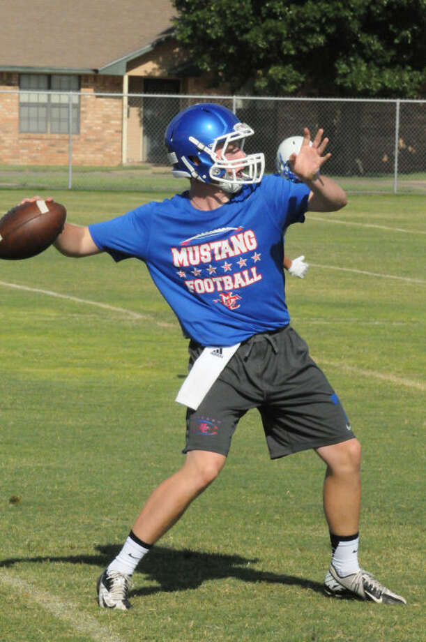 Midland Christian quarterback Mason McClendon throws a pass during a workout Wednesday at Wayland Baptist University in Plainview. Photo by Kevin Lewis/Wayland Baptist University