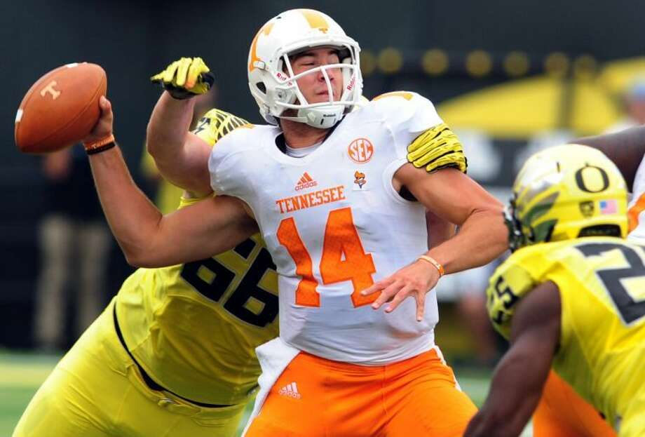 Tennessee quarterback Justin Worley (14) is sacked by Oregon defensive tackle Taylor Hart (66) during the second quarter of an NCAA college football game in Eugene, Ore., Saturday, Sept. 14, 2013. Oregon won the game 59-14. (AP Photo/Steve Dykes) Photo: Steve Dykes