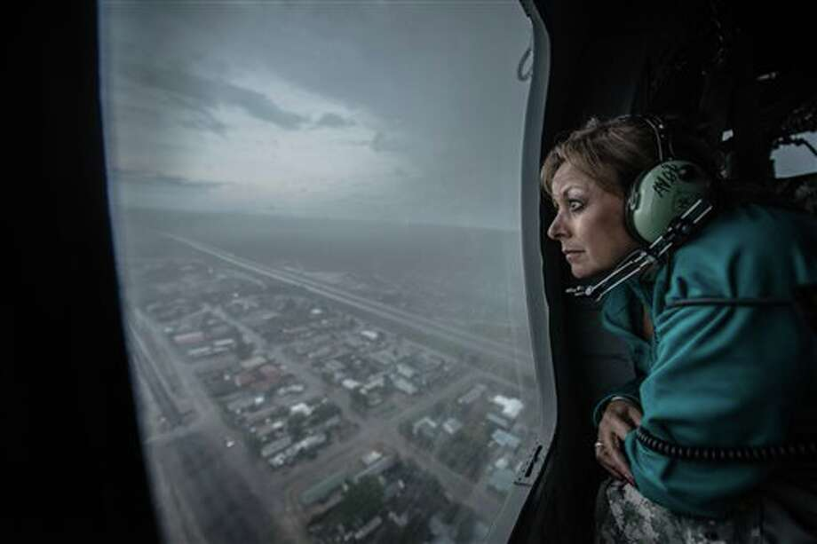 Governor Susana Martinez(Cq) gets a bird's eye view of the city of Las Vegas, New Mexico from a Red Cross Blackhawk helicopter during a tour to assess the damage caused by the recent floods Las Vegas, New Mexico. Isleta, New Mexico. The massive flooding prompted Gov. Susana Martinez to issue a state of emergency, opening up recovery funding after rivers overflowed because of heavy rains and caused millions of dollars in damage. (AP Photo/Albuquerque Journal, Roberto E. Rosales) Photo: Roberto E. Rosales / Albuquerque Journal