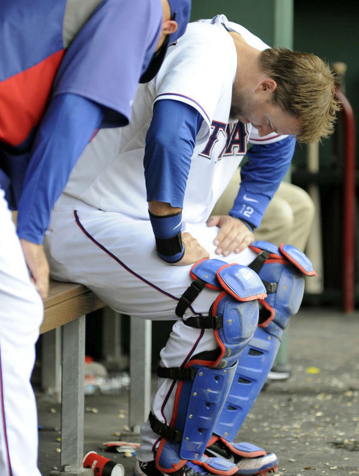 Texas Rangers catcher A.J. Pierzynski reacts in the dugout during the ninth inning against the Oakland Athletics on Sunday in Arlington. The Athletics won 5-1, completing a three-game sweep of the series. (AP Photo/Matt Strasen)