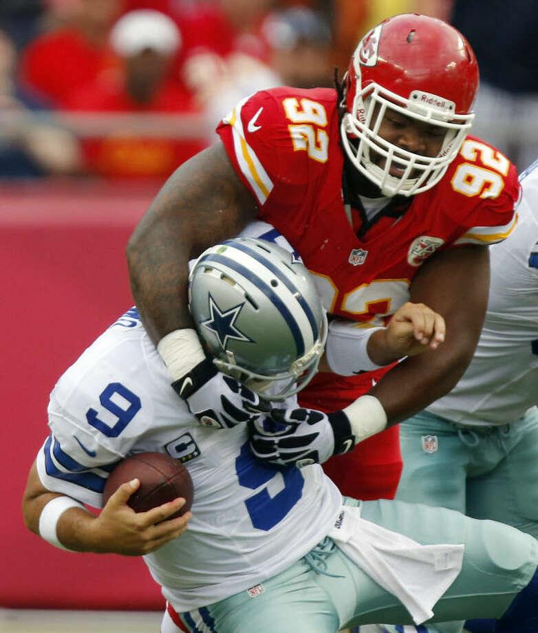 Dallas Cowboys quarterback Tony Romo (9) is sacked by Kansas City Chiefs nose tackle Dontari Poe (92) during the first half of an NFL football game at Arrowhead Stadium in Kansas City, Mo., Sunday, Sept. 15, 2013. (AP Photo/Ed Zurga) Photo: Ed Zurga