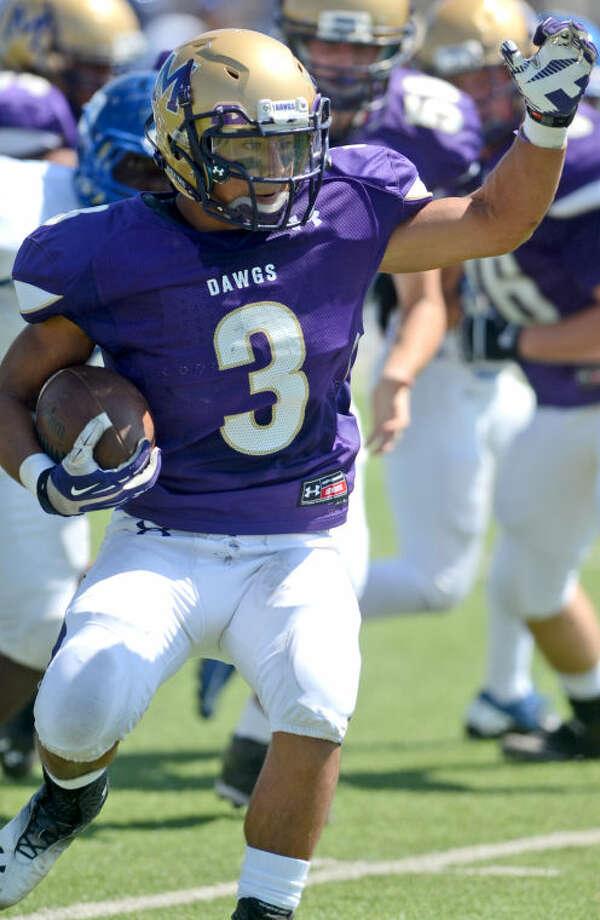 Midland's Brandon Infiesto runs the ball against EP Americas on Saturday at Grande Communications Stadium. James Durbin/Reporter-Telegram Photo: JAMES DURBIN