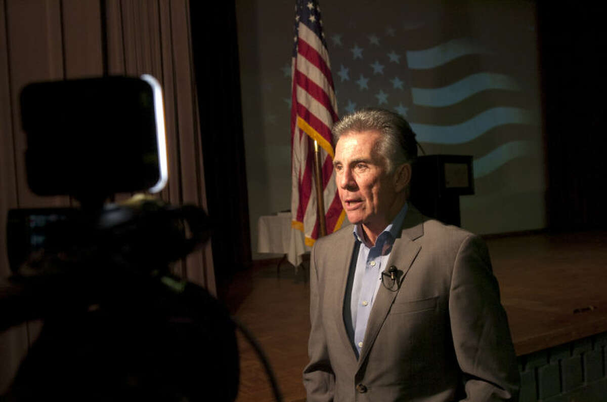 """John Walsh of """"America's Most Wanted"""" speaks to the media during the 200 Club Law Enforcement Appreciation Banquet on Tuesday at the Midland Center. James Durbin/Reporter-Telegram"""
