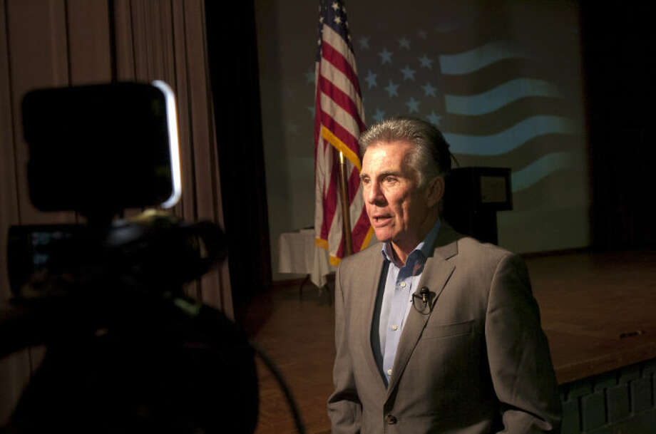 """John Walsh of """"America's Most Wanted"""" speaks to the media during the 200 Club Law Enforcement Appreciation Banquet on Tuesday at the Midland Center. James Durbin/Reporter-Telegram Photo: JAMES DURBIN"""
