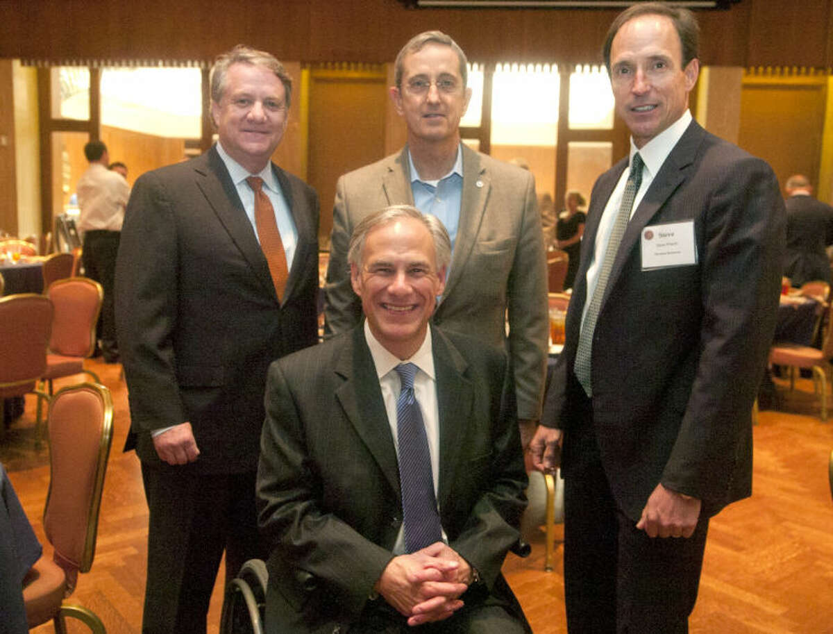 From left, Ben Shepperd, Texas Attorney General Greg Abbott, Jerry Patterson, land commissioner, and Steve Pruett, chairman of PBPA, pose for a picture during the Permian Basin Petroleum Association's monthly membership luncheon Thursday at the Petroleum Club. James Durbin/Reporter-Telegram