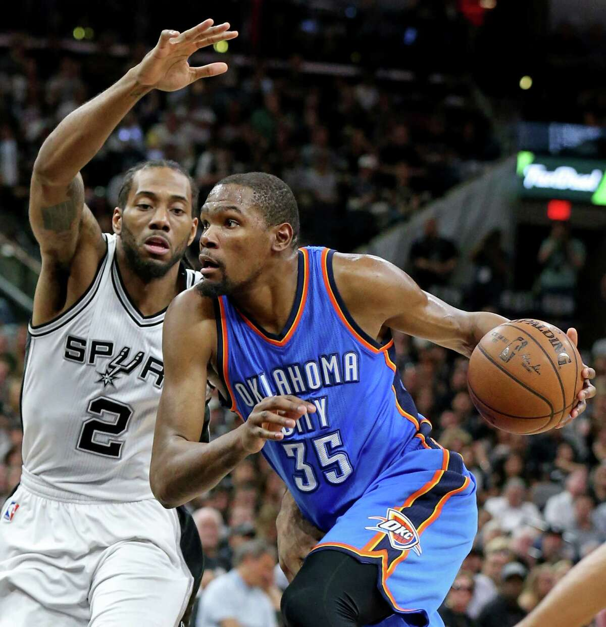 San Antonio Spurs' Kawhi Leonard defends Oklahoma City Thunder's Kevin Durant during first half action of Game 5 in the Western Conference semifinals Tuesday May 10, 2016 at the AT&T Center.
