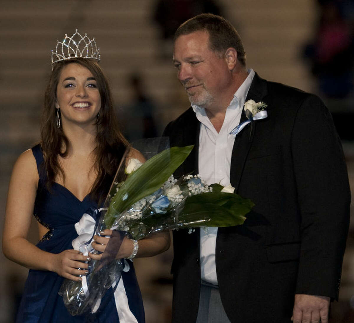 Greenwood senior Hannah Peine is named 2013 Homecoming Queen and is escorted by her father Greg Paine. Tim Fischer\Reporter-Telegram