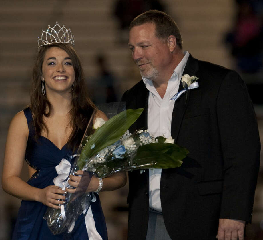 Greenwood senior Hannah Peine is named 2013 Homecoming Queen and is escorted by her father Greg Paine. Tim Fischer\Reporter-Telegram Photo: Tim Fischer