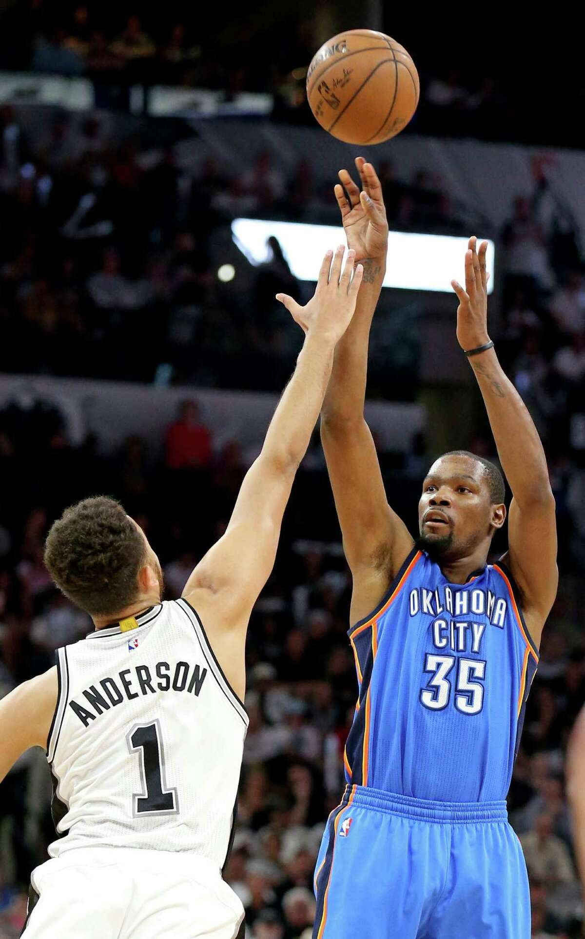 Oklahoma City Thunder's Kevin Durant shoots over San Antonio Spurs' Kyle Anderson during first half action of Game 5 in the Western Conference semifinals Tuesday May 10, 2016 at the AT&T Center.