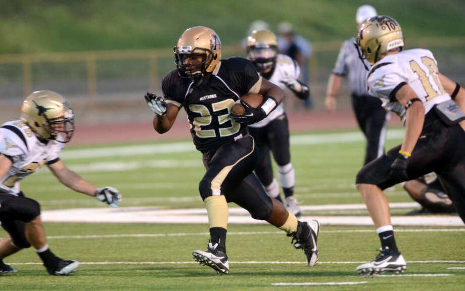 Andrews running back Tajh Kelly runs the ball against Big Spring on Friday at Mustang Bowl in Andrews. James Durbin/Reporter-Telegram Photo: JAMES DURBIN