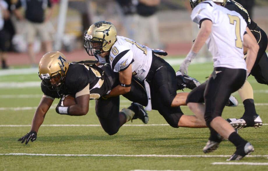 Andrews running back Tajh Kelly is tackled by Big Spring's Devin Roberson on Sept 20 at Mustang Bowl in Andrews. James Durbin/Reporter-Telegram Photo: JAMES DURBIN
