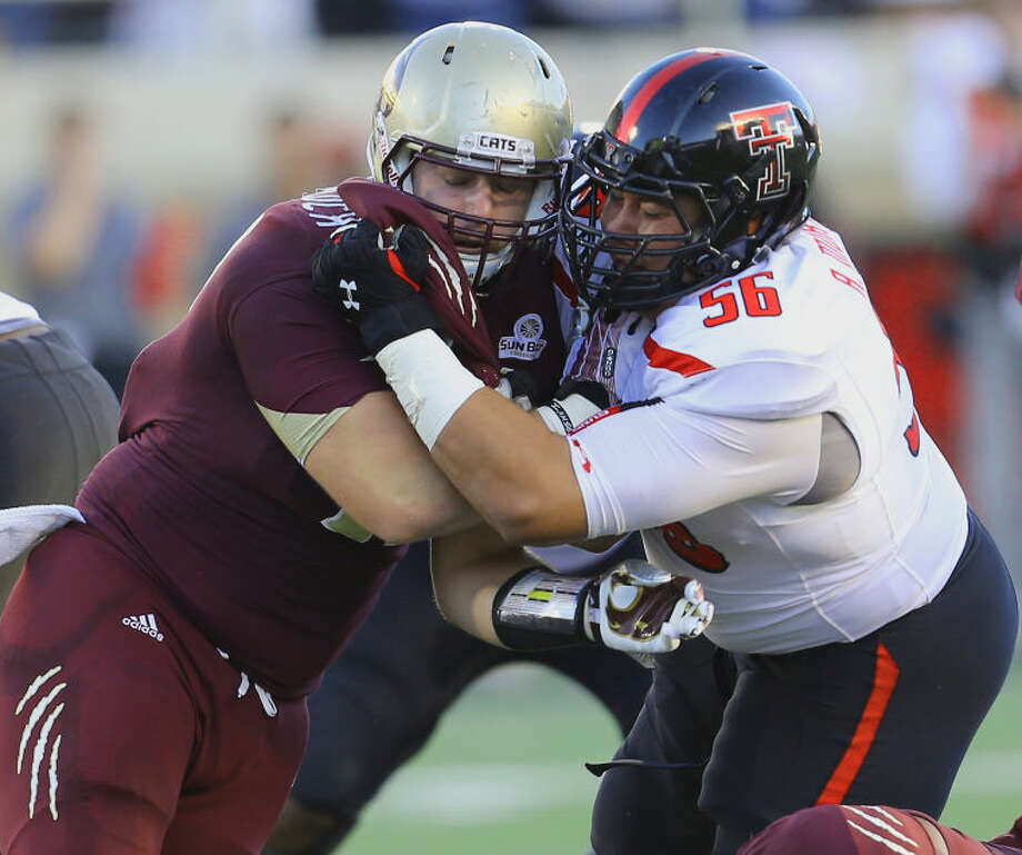 Texas State defensive tackle and former Greenwood standout Blake McColloch (91) attacks Texas Tech's offensive line in Saturday night's game at Jones AT&T Stadium in Lubbock. Photo: Wade H Clay