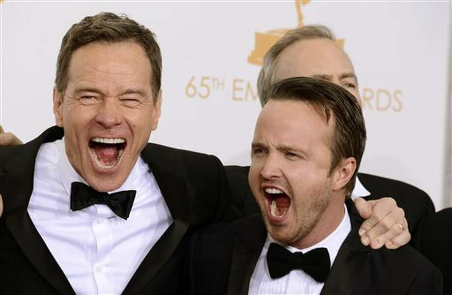 "Bryan Cranston, left, and Aaron Paul, winners of the best drama series award for ""Breaking Bad"" pose backstage at the 65th Primetime Emmy Awards at Nokia Theatre on Sunday Sept. 22, 2013, in Los Angeles. (Photo by Dan Steinberg/Invision/AP) Photo: Dan Steinberg / Invision"