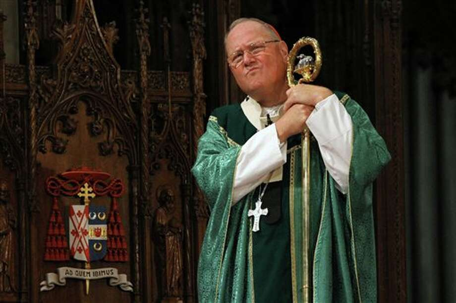 """Cardinal Timothy Dolan, listens during Mass, Sunday, Sept. 22, 2013, at St. Patrick's Cathedral in New York. Pope Francis' said Sept. 19, that pastors should focus less on divisive social issues and should emphasize compassion over condemnation. Dolan told reporters that Francis, """"speaks like Jesus"""" and is a """"breath of fresh air."""" (AP Photo/Tina Fineberg) Photo: Tina Fineberg / FR73987 AP"""