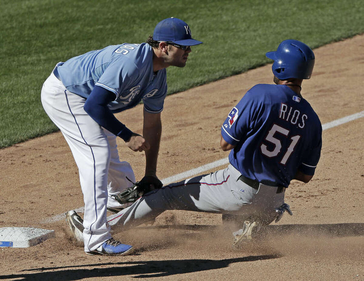Kansas City Royals third baseman Mike Moustakas forces Texas Rangers' Alex Rios (51) out at third Sunday in Kansas City, Mo. The Royals won 4-0 in 10 innings. (AP Photo/Charlie Riedel)