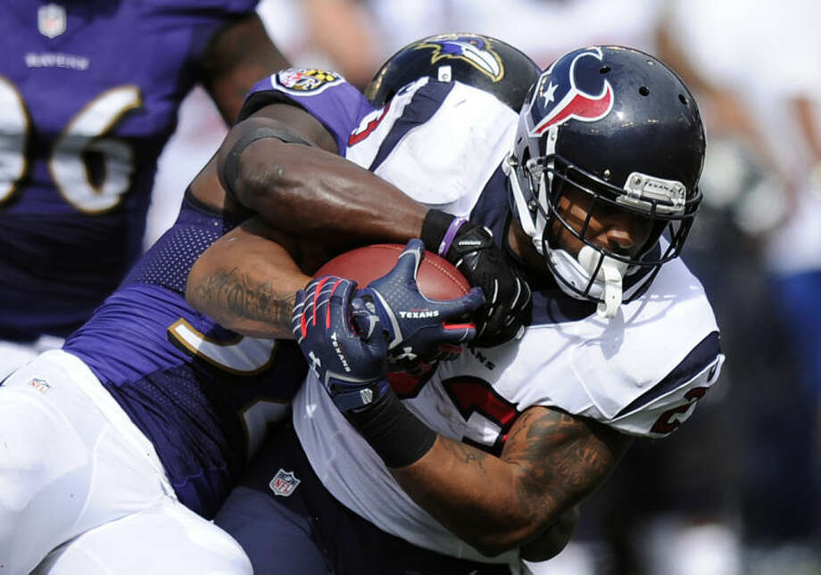Houston Texans running back Arian Foster is tackled by Baltimore Ravens strong safety James Ihedigbo on Sunday in Baltimore. (AP Photo/Nick Wass) Photo: Nick Wass