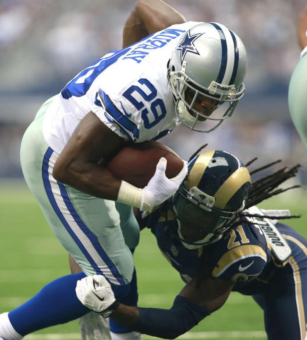 Dallas Cowboys running back DeMarco Murray (29) is tackled by St. Louis Rams cornerback Janoris Jenkins (21) Sunday in Arlington.(AP Photo/Waco Tribune Herald, Jose Yau)