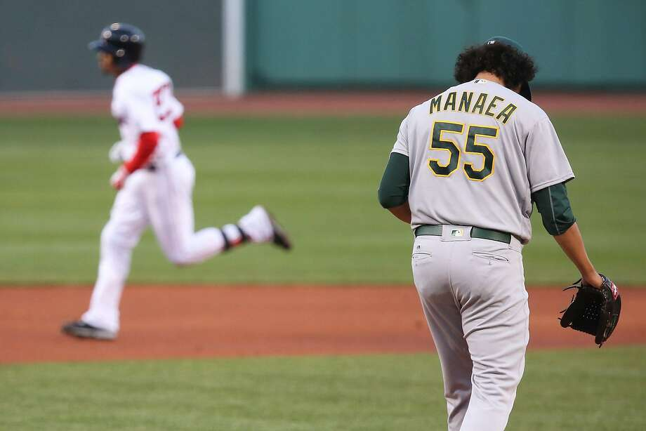 Mookie Betts #50 of the Boston Red Sox rounds the bases after hitting a home run as Sean Manaea #55 of the Oakland Athletics looks on in the first inning at Fenway Park on May 10, 2016 in Boston, Massachusetts. Photo: Adam Glanzman, Getty Images