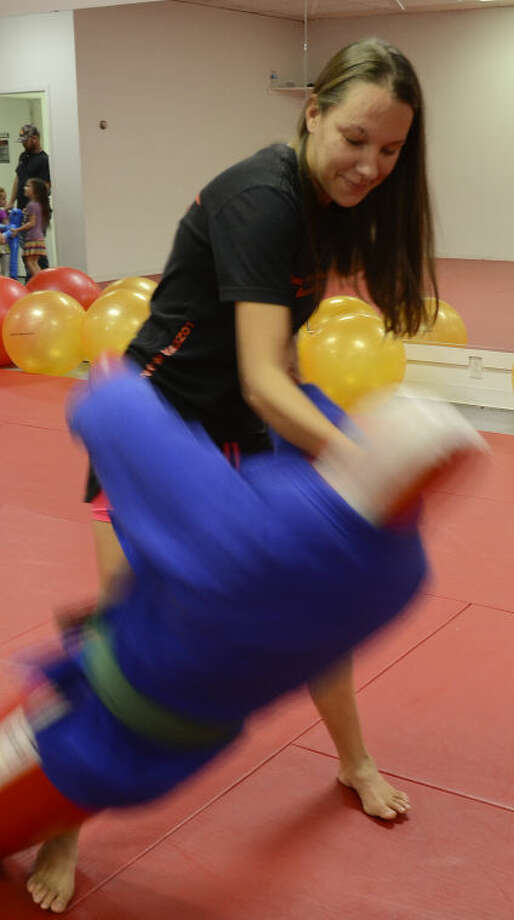 Tosha West, who suffers from muscular dystrophy, has started taking Brazilian jiu jitsu and seen a vast improvement in her muscular condition and balance. Tim Fischer\Reporter-Telegram Photo: Tim Fischer