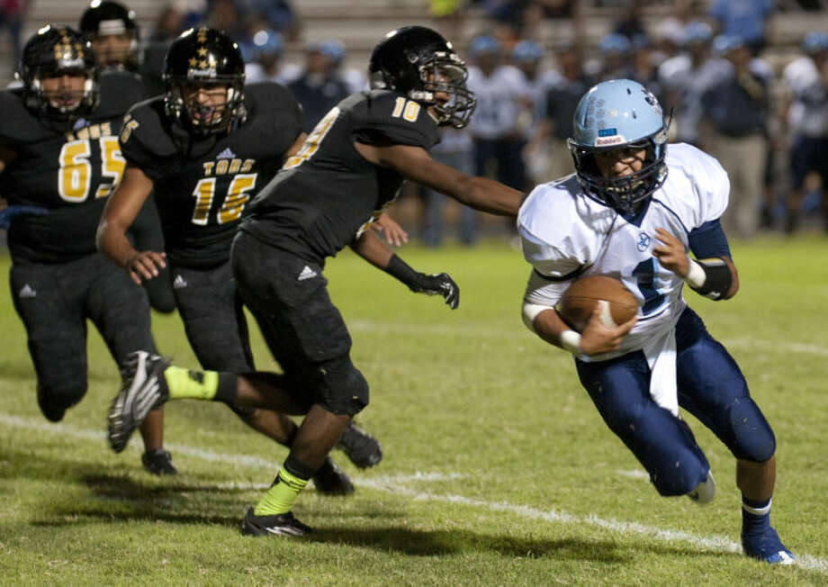 Greenwood's Anthony Salas gets around the side as he gains some yards two weeks ago in Lamesa. Tim Fischer\Reporter-Telegram Photo: Tim Fischer