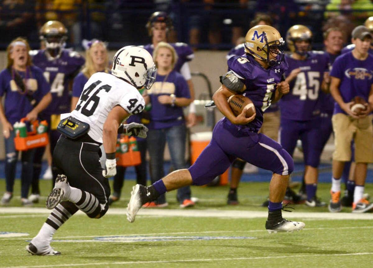 Midland's Lance White runs the ball back for a touchdown against Permian on Friday at Grande Communications Stadium. James Durbin/Reporter-Telegram
