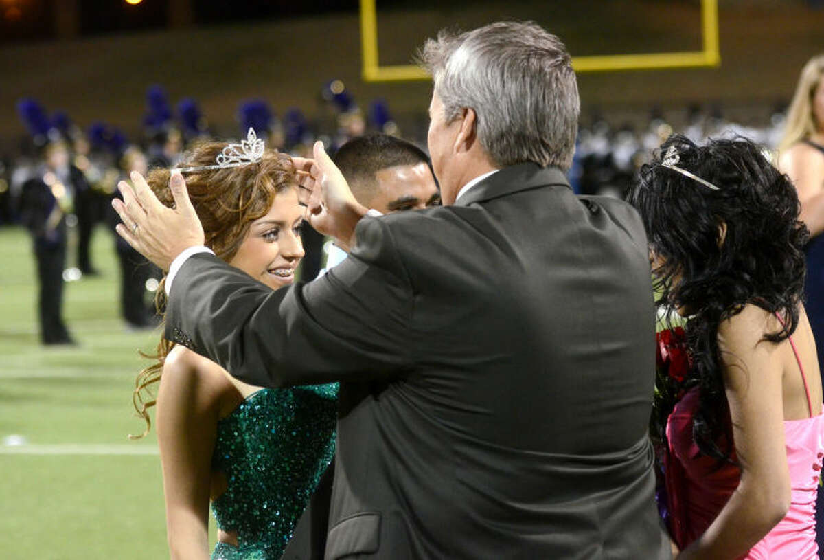 Midland High principal Jeff Horner crowns Adriana Montez homecoming queen at halftime during the Homecoming game against Permian on Friday at Grande Communications Stadium. James Durbin/Reporter-Telegram