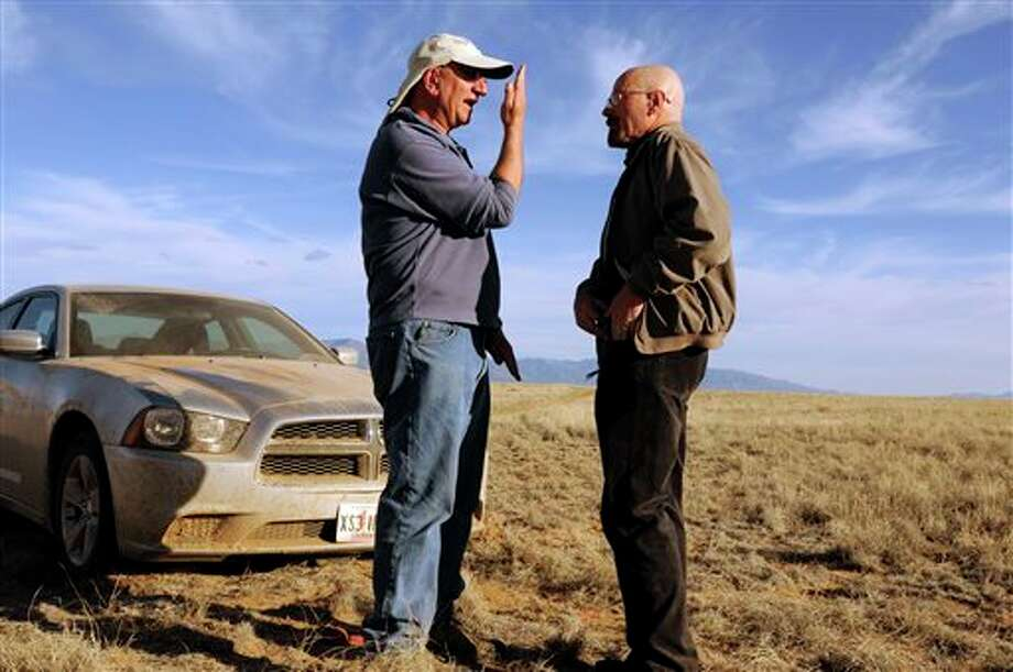 "This 2012 photo released by AMC shows cinematographer Michael Slovis, left, and Bryan Cranston on the set of ""Breaking Bad."" The series finale will air on Sunday, Sept. 29. (AP Photo/AMC, Ursula Coyote) Photo: Ursula Coyote / AMC"